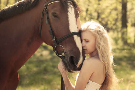 horse blonde: beautiful girl and a horse