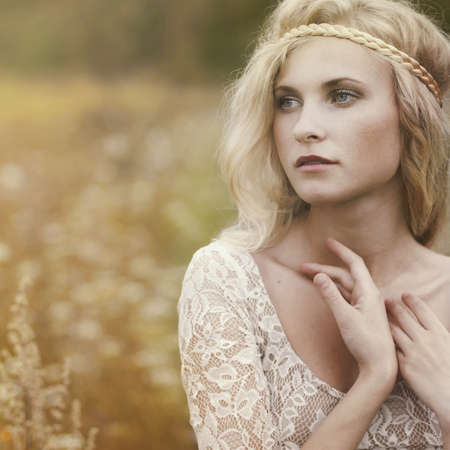 beautiful blonde in the field Stock Photo