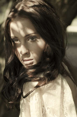 wise woman: portrait of a beautiful brunette with sunspots