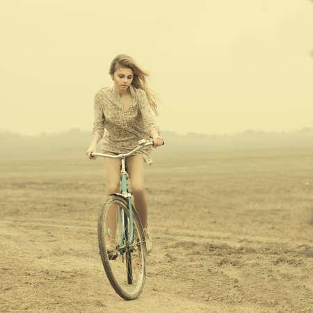 road cycling: beautiful girl hipster bike