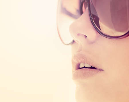 sun glasses: young beautiful woman in glasses outdoors