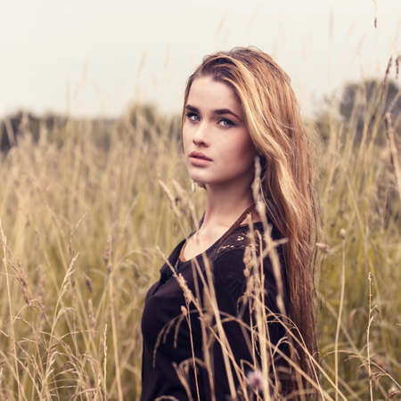 portrait of a beautiful blonde in a field in spring  Stock Photo