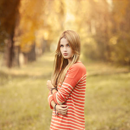portrait of a beautiful young woman in a summer park  pictures in warm colors Stock Photo - 25985695