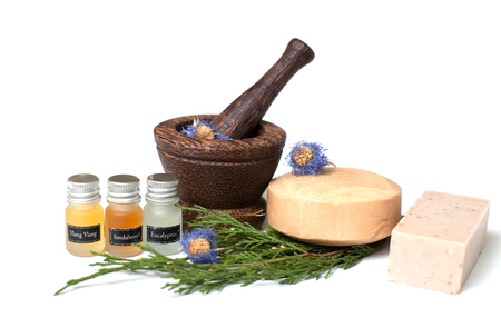 sandalwood: Wooden pounder with bottles of oils and soap Stock Photo