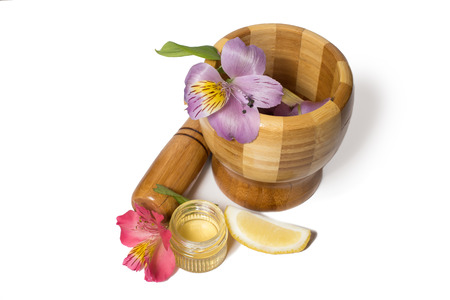 pounder: Wooden bamboo pounder with honey and colorful flowers