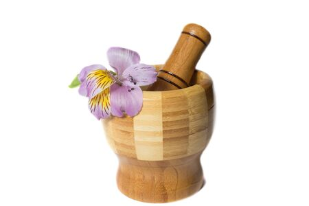 pounder: Wooden bamboo pounder with magenta flower isolated Stock Photo