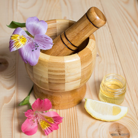 pounder: Wooden bamboo pounder with flowers and honey
