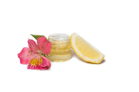 alstromeria: Honey in bottle, pink alstromeria and lemon isolated Stock Photo