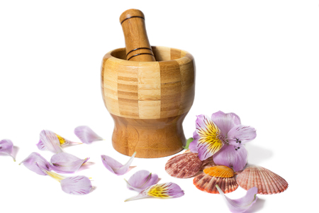 pounder: Wooden bamboo pounder with flowers and petals