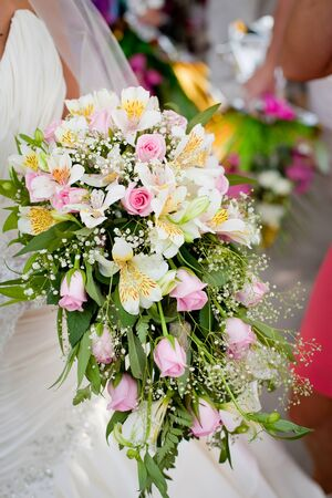 alstromeria: Colorful wedding bouquet in bride hands with eustomas and alstromeria