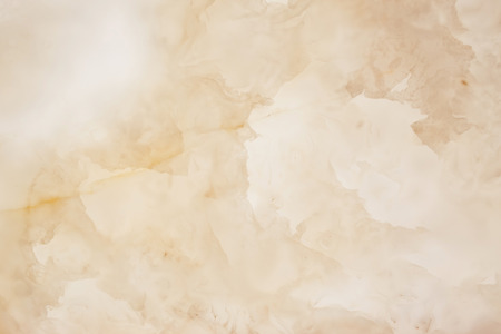 Slighty blurred lightened slices marble. Horizontal image. Warm colors. Beautiful close up background. Ideal for sites, banners, brochures, design