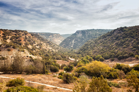 rout: Beautiful mountain view of Cyprus near Pafos. Rout to Avaas gorge cave. Top view, colorful horizontal image Stock Photo