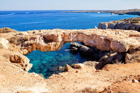 greco: Natural bridge in Cavo Cape Greco, at National Forest Park, Ayia Napa. Turquoise water in the Mediterranean Sea Stock Photo