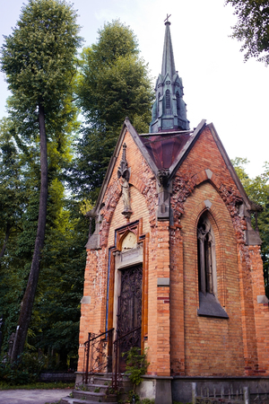 crypt: Old crypt in the Lychakiv Cemetery. Lviv, Ukraine. Vertical color photo