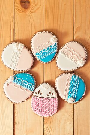 gingery: Easter homemade gingerbread pink and blue cookie  on wooden table. Colorful image, top view