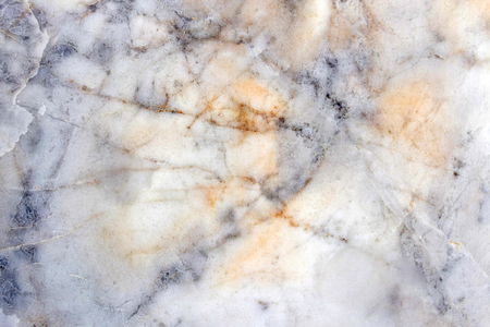 Slightly lightened slices marble background. Horizontal image. Cold and warm gray and yellow vivid colors. Beautiful close up background. Ideal for sites, banners, brochures, design