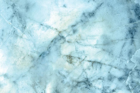 Slightly lightened slices marble background. Horizontal image. Cold blue vivid colors. Beautiful close up background. Ideal for sites, banners, brochures, design
