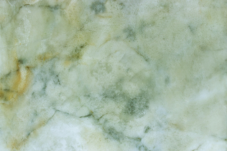 Slightly lightened slices marble background. Horizontal image. Warm and cold natural green colors. Beautiful close up background. Ideal for sites, banners, brochures, design