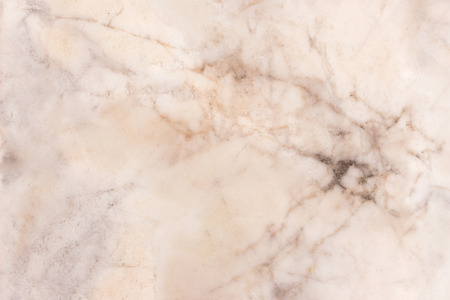 Slightly lightened slices marble background. Horizontal image. Warm and cold natural yellow colors. Beautiful close up background. Ideal for sites, banners, brochures, design 免版税图像
