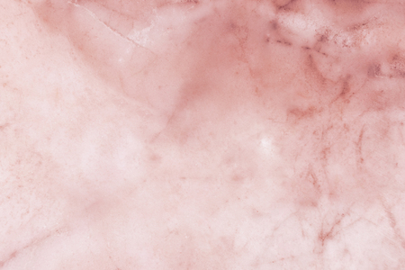 Slightly lightened slices marble background. Horizontal image. Warm orange red pastel colors. Beautiful close up background. Ideal for sites, banners, brochures, design 免版税图像