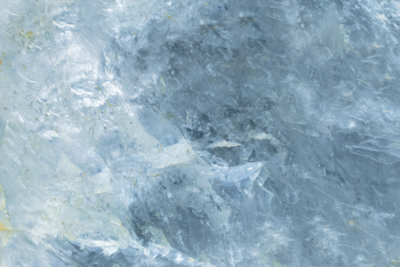 Horizontal lightened slices of blue marble quartz ice background. Cold calm colors icy background ideal for your design 免版税图像