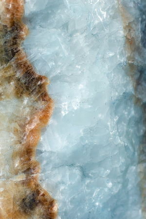 Vertical lightened slices of blue marble quartz ice background. Cold calm colors icy background ideal for your design