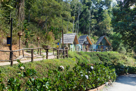 Ecotourism destinations Hoa Son Dien Trang - new tourist park in the mountains of the Vietnam city Da Lat. Lovely colorful buildings and photo zones. Good sightseeing place for eco tourists. Horizontal color image for travel agency, sites, banners etc 免版税图像