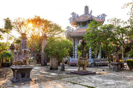 Chua Tan Thai famous pagoda and temple in Da Nang, Vietnam. A place to visit in Danang. Sunset at the pagoda. Horizontal colorful image ideal for travel agencies, advertising, banners, web etc