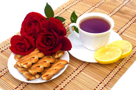 cup of tea with cookies and lemon photo