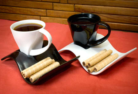 two cups of coffee and wafer sticks with chocolate photo