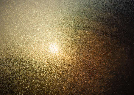 looking through window: the sun shines through the fog on the glass and drops of water Stock Photo