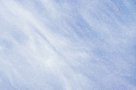 snow falls: Snow falls on the background of blue clouds.