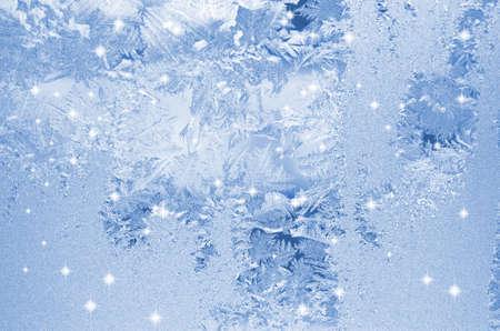 Frost patterns on window. Festive bokeh background 版權商用圖片