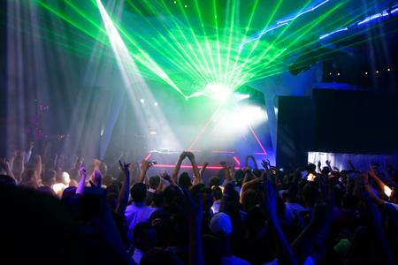 Night club dj party people enjoy of music dancing sound with colorful light . Stock Photo - 76157873