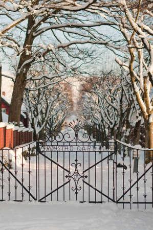 wicket gate: Stavanger, Norway  Unusual vestcoat winter  Iron gates  Stock Photo