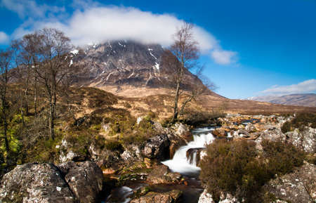 Spring stream in Glen Etive in Scotland photo