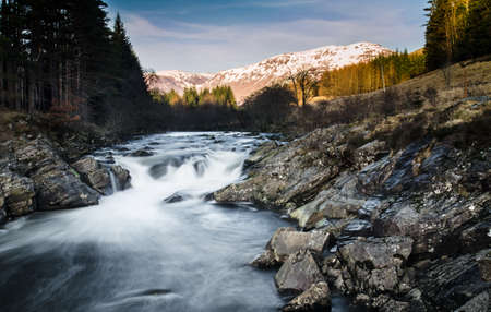 Waterfall in Glen of Orchy in Scotland photo