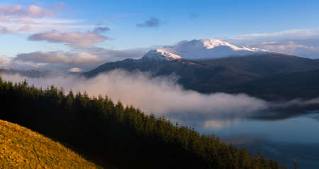 Sun just touch the top of mountain Ben Lomond in Scotland  photo