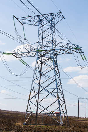 megawatts: high voltage electric power lines on pylons, power transmission tower