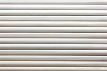 garage door: Roller shutter door. Striped textured white garage door background