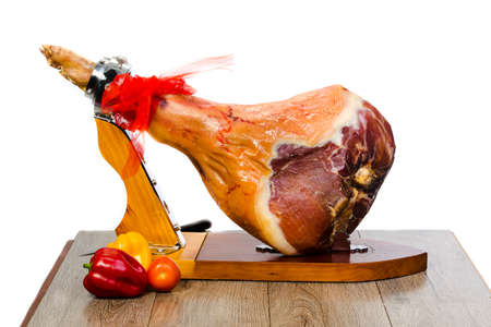 Parma ham (jamon) on a wooden stand isolated on white background