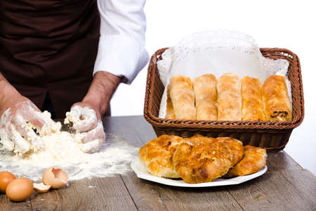 knead: hands knead the dough for baking, with ready-made products on the table