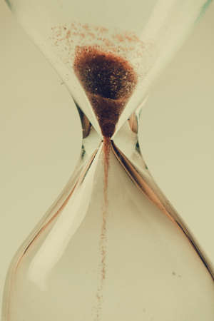 time flies: Sand flowing through an hourglass concept for time running out, background