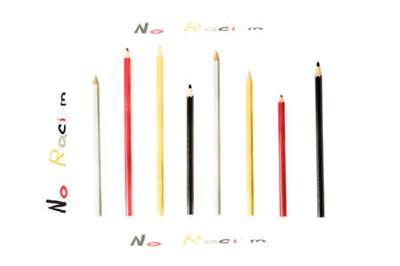 racismo: conceptual background with red, black, white and yellow pencils with inscription  No Racism, No racism concept