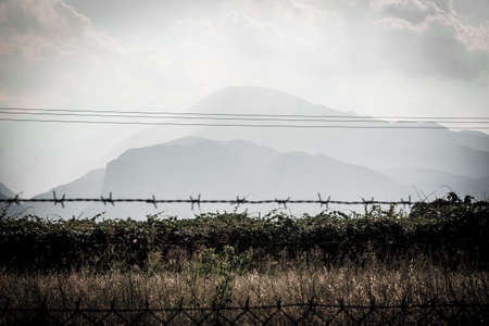 olympus: silhouette of Mount Olympus behind bars, concept of danger of conquering mountain peaks
