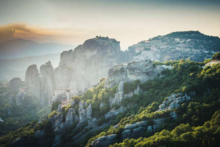 Meteors monasteries in Greece in high mountains on the sunset, background 写真素材