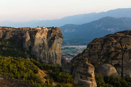 Meteors monasteries in Greece in high mountains on the sunset, background Stock Photo