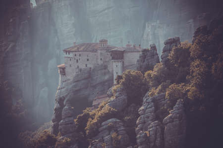 seclusion: Meteors monasteries in Greece in high mountains on the sunset, background Stock Photo