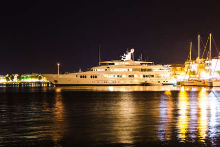luxurious modern private yacht at the pier at night. Zakynthos, Greece