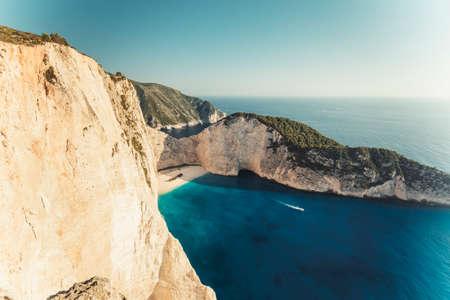 swimm: Navagio beach with shipwreck and motor boat on Zakynthos island, Greece, background